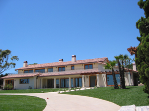 2 piece clay tile with copper gutters and custom chimney caps in Malibu