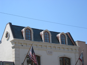Slate roof with copper radius  and copingin West Hollywood
